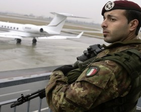 Italian army paratrooper guarding the Torino 2006 Winter Olympic Games keeps watch at Turin's airport