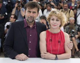 "Director Nanni Moretti and cast member Margherita Buy pose during a photocall for the film ""Mia madre"" in competition at the 68th Cannes Film Festival in Cannes"