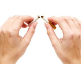 Woman breaking a cigarette. Isolated on a white background.