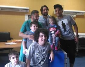 Il calciatore del Napoli Allan in visita all'ospedale Monaldi a Napoli