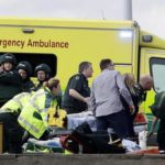 """Emergency services staff provide medical attention close to the Houses of Parliament in London, Wednesday, March 22, 2017. London police say they are treating a gun and knife incident at Britain's Parliament """"as a terrorist incident until we know otherwise."""" Officials say a man with a knife attacked a police officer at Parliament and was shot by officers. There are also reports of a vehicle hitting pedestrians on nearby Westminster Bridge. (ANSA/AP Photo/Matt Dunham)"""