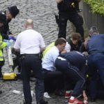 """Emergency services at the scene outside the Palace of Westminster, London, Wednesday, March 22, 2017.  London police say they are treating a gun and knife incident at Britain's Parliament """"as a terrorist incident until we know otherwise."""" The Metropolitan Police says in a statement that the incident is ongoing. It is urging people to stay away from the area. Officials say a man with a knife attacked a police officer at Parliament and was shot by officers. Nearby, witnesses say a vehicle struck several people on the Westminster Bridge.  (Stefan Rousseau/PA via AP)."""