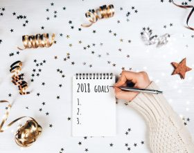Holiday decorations and notebook with 2017 goals