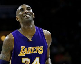 FILE In this Dec. 1, 2015 file photo Los Angeles Lakers' Kobe Bryant smiles as he jogs to the bench during the first half of an NBA basketball game against the Philadelphia 76ers in Philadelphia. The Retired NBA superstar has died in helicopter crash in Southern California, Sunday, Jan. 26, 2020. (AP Photo/Matt Slocum)