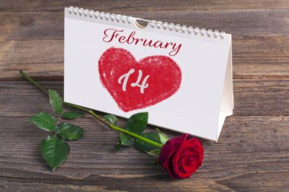 Saint Valentine calendar on rustic wooden table