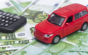 red car and money, euro and dollars. insurance concept